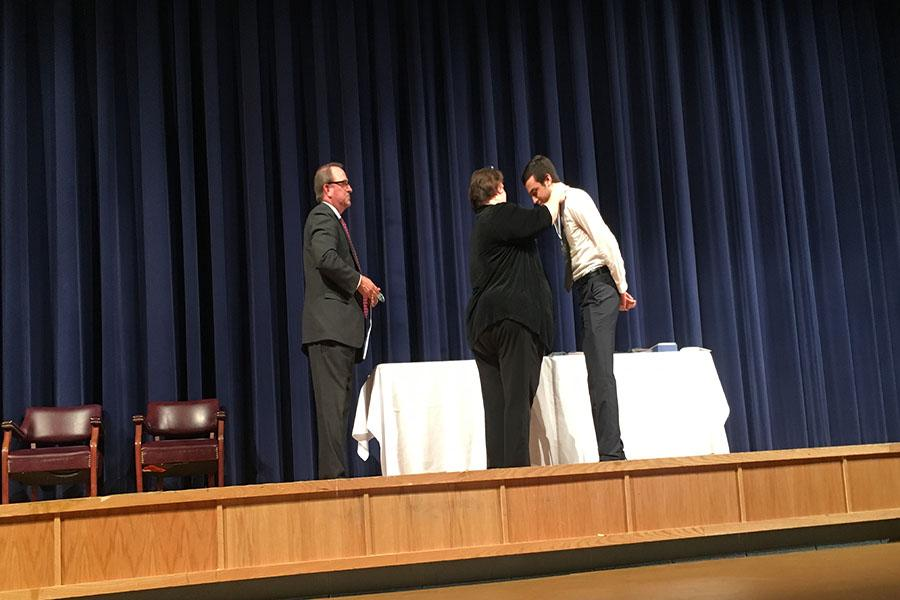 Senior Yusuf Aboutabl receives a silver medal for two department recognitions