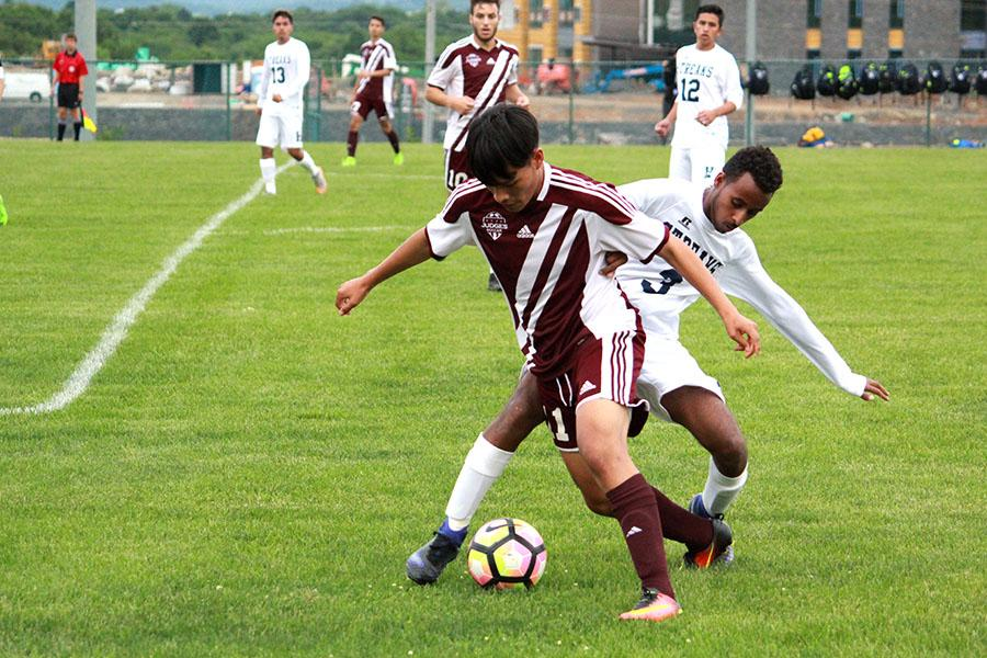 Junior Huruy Abraha stabs at a ball during the first half of the match.