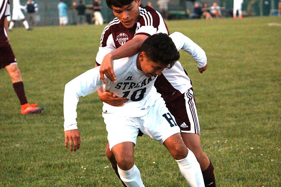 Ramirez tries to shake off a defender.