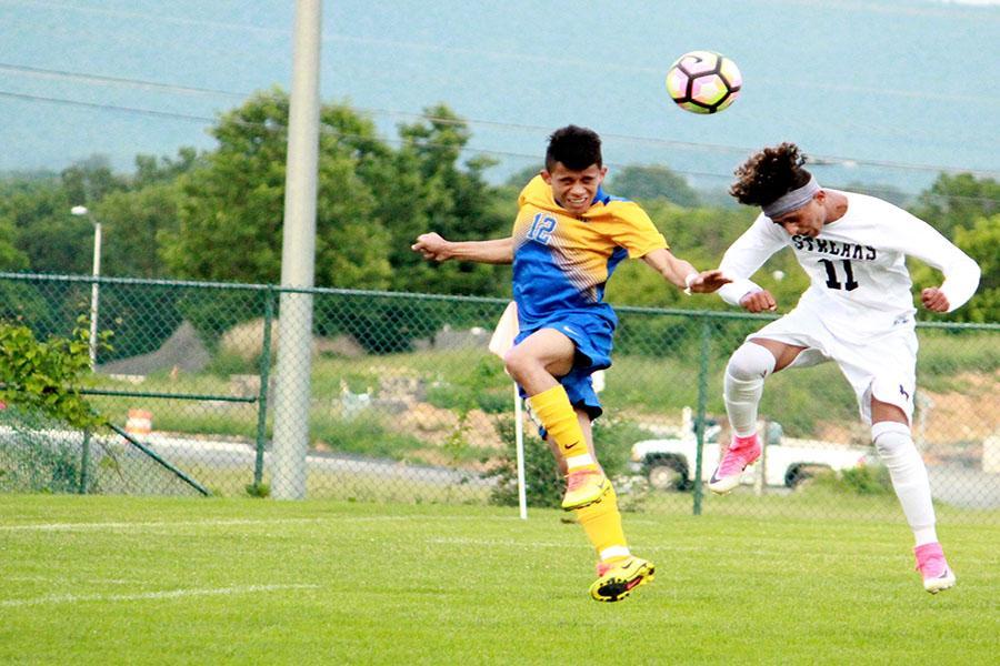 Imran heads the ball towards goal.