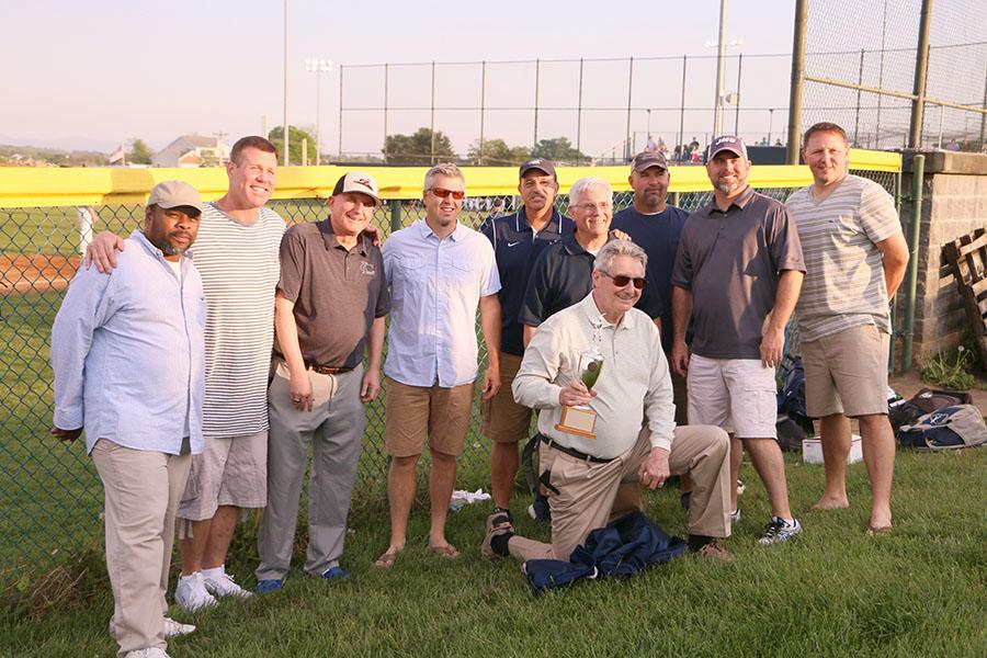 All members of the 1992 streaks baseball team who could attend Friday's reunion pose for a photo.