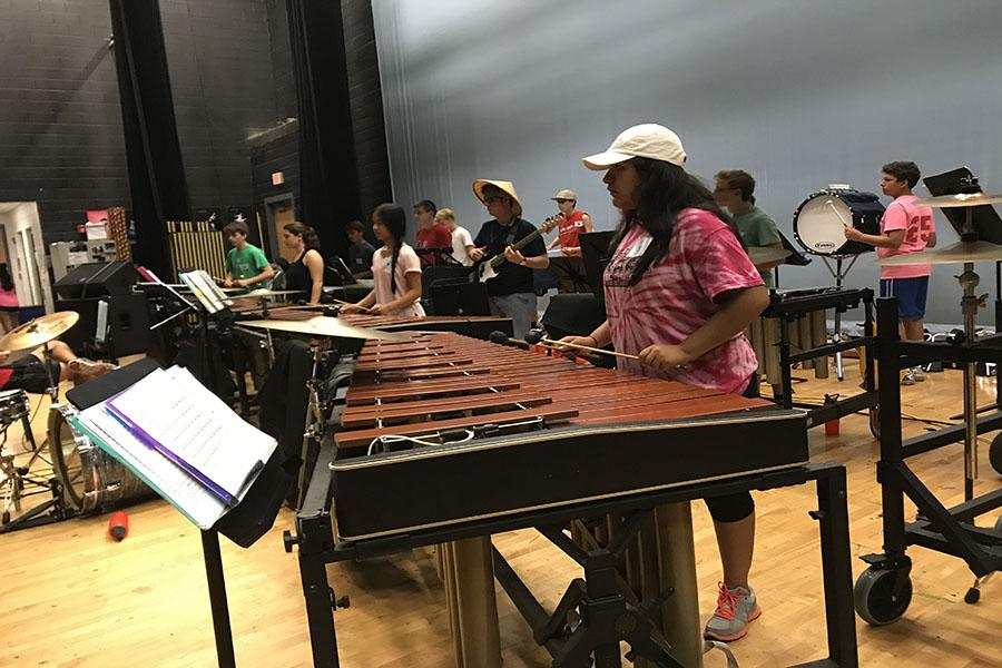 Junior Alexia Muñoz prepares for the upcoming concert as the percussion team practices during band camp