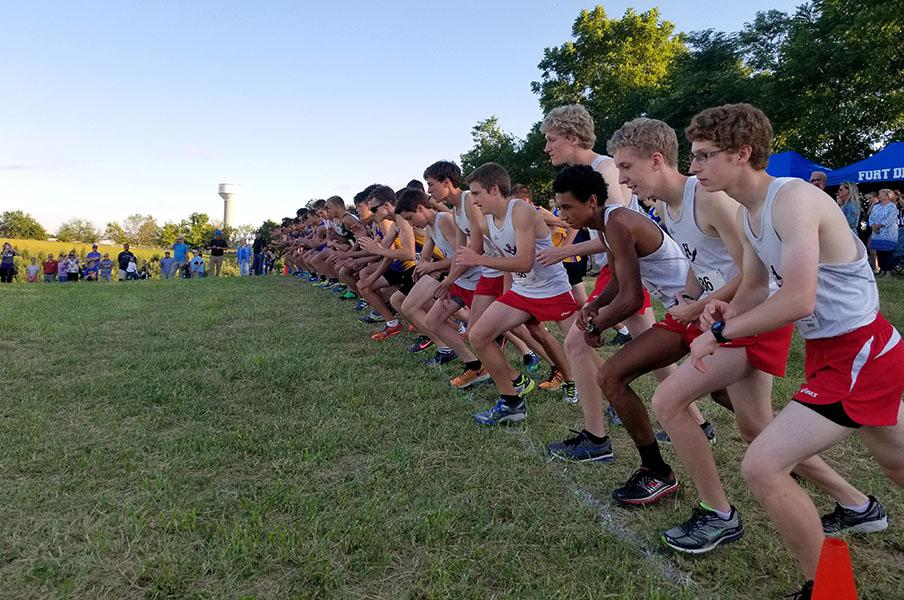 The+boys+of+the+varsity+cross+country+team+step+up+to+the+line+seconds+before+the+race+starts.