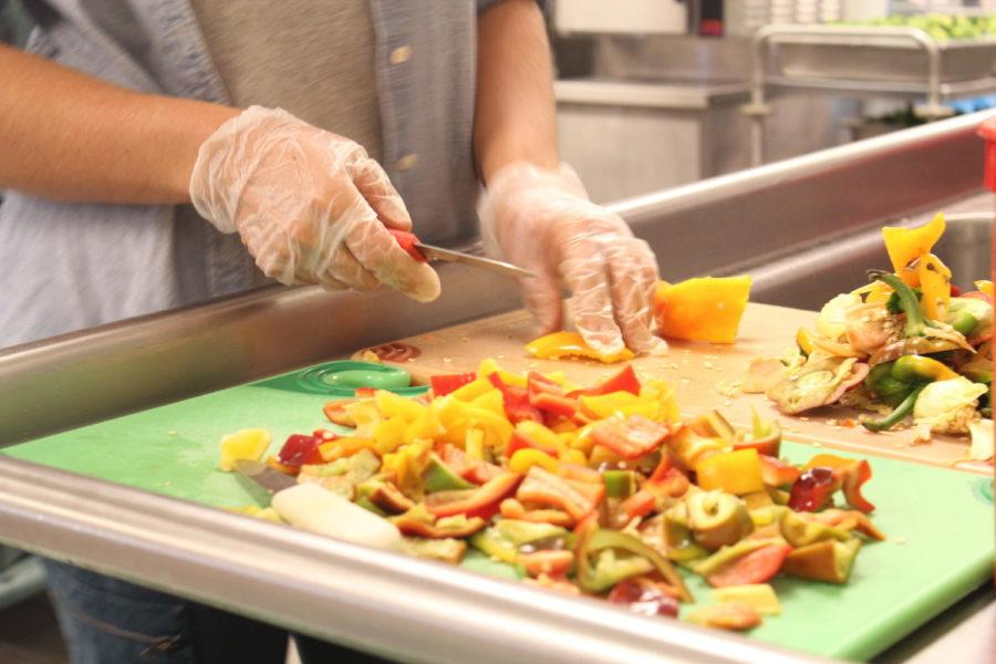 Laura Smith prepares locally grown peppers for the elementary school students to try