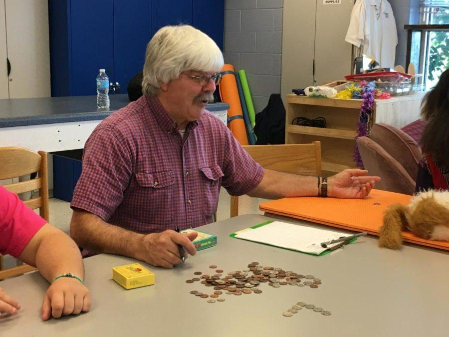 Walt Williamson works on change-counting skills with his first period class