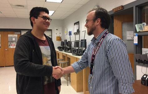Junior Carlo Mehegan and Harrisonburg High School teacher Seth Shantz demonstrate  respect between a student and teacher with a handshake and a smile