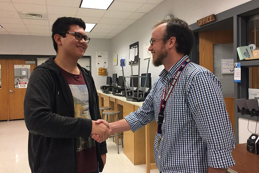 Junior+Carlo+Mehegan+and+Harrisonburg+High+School+teacher+Seth+Shantz+demonstrate++respect+between+a+student+and+teacher+with+a+handshake+and+a+smile