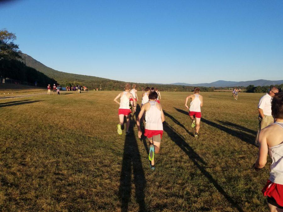 The varsity team take a stride out before there race at Burtner.
