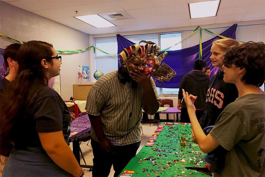 Foreign language students have fun with masks found in Creole cultures.