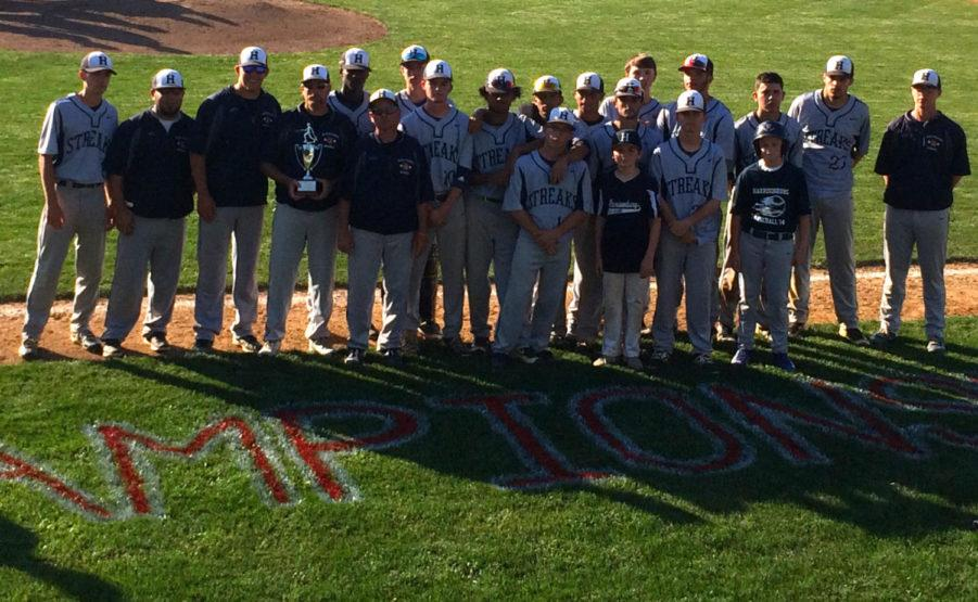 The Streaks varsity baseball team holds their trophy after playing Liberty Christian Academy