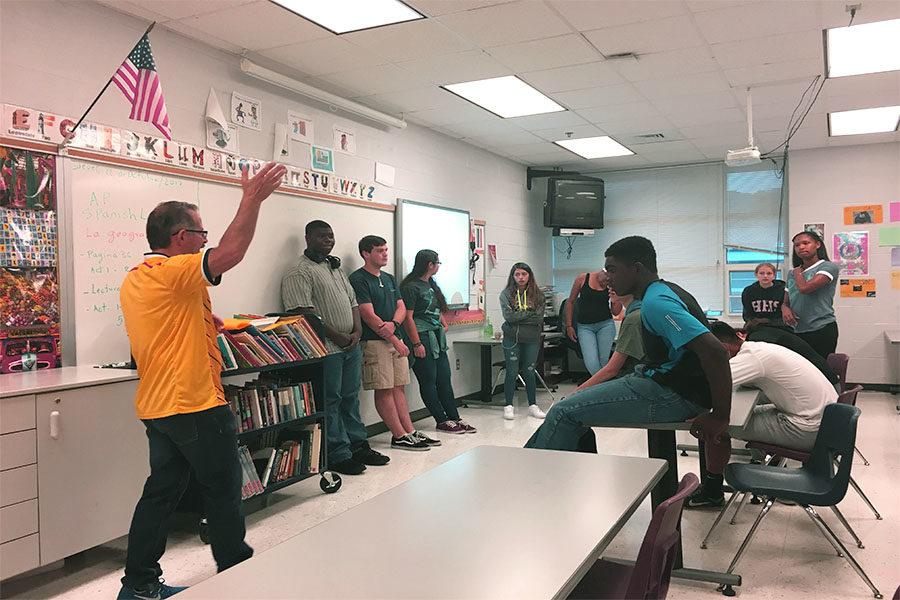 Spanish teacher Henry Garcia gives a presentation on Colombia to foreign language students.