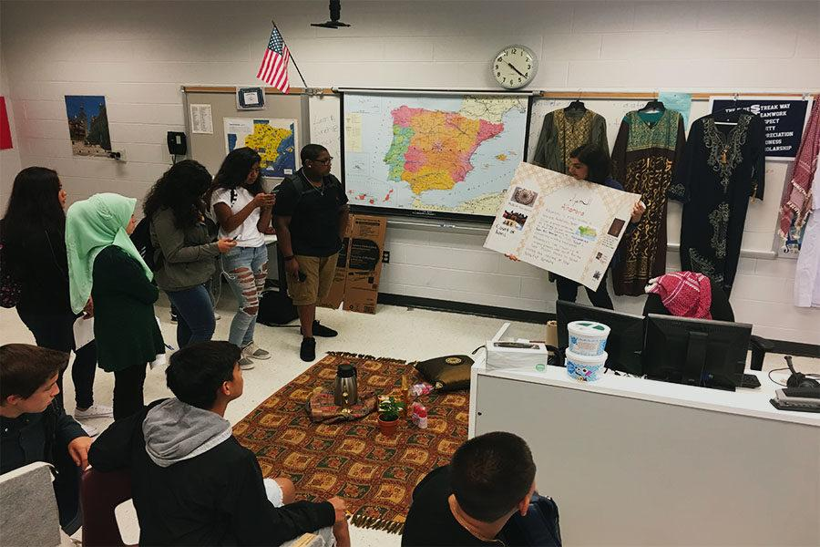 Arabic teacher Israa Alhassani teaches foreign language students about Arabian culture.