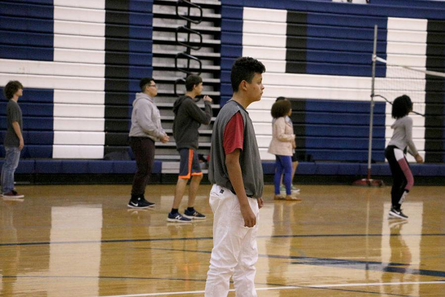 The Sports and Games class plays volleyball.