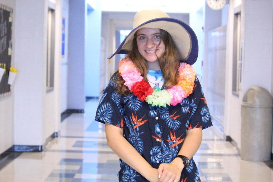 Junior Jayln Sneary poses for a photo in Hawaiian gear.
