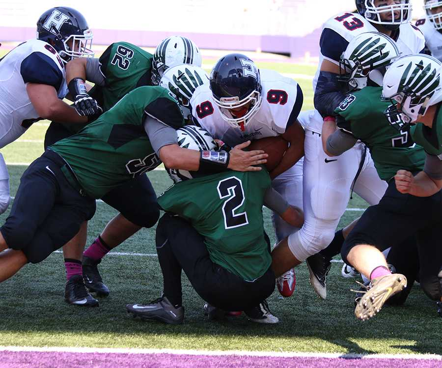 Junior Marcus Robinson-Jenkins runs up the middle on the goal line to score a touchdown against the Gobblers of Broadway. The Streaks went on to beat the Gobblers 35-6.