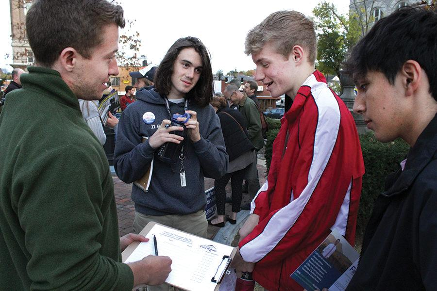 "Seniors Jack O'Brien and Martin Beck sign up to help local politician Brent Finnegan with his campaign. Finnegan is in favor of a new Harrisonburg High School. ""I wouldn't say I'm against Students Over Structures. I would say I'm for funding education from the state level, making it a priority at the state level,"