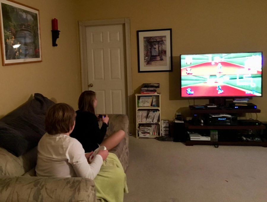The Lankford family takes part in a game of Mario Kart