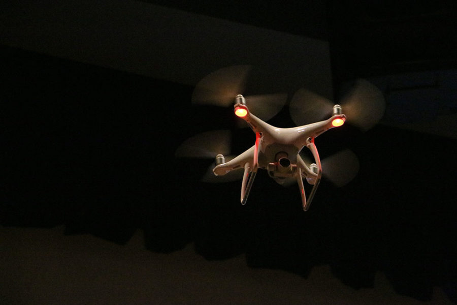 A+drone+is+flown+around+the+auditorium+as+part+of+a+Fire+Department+demonstration.+