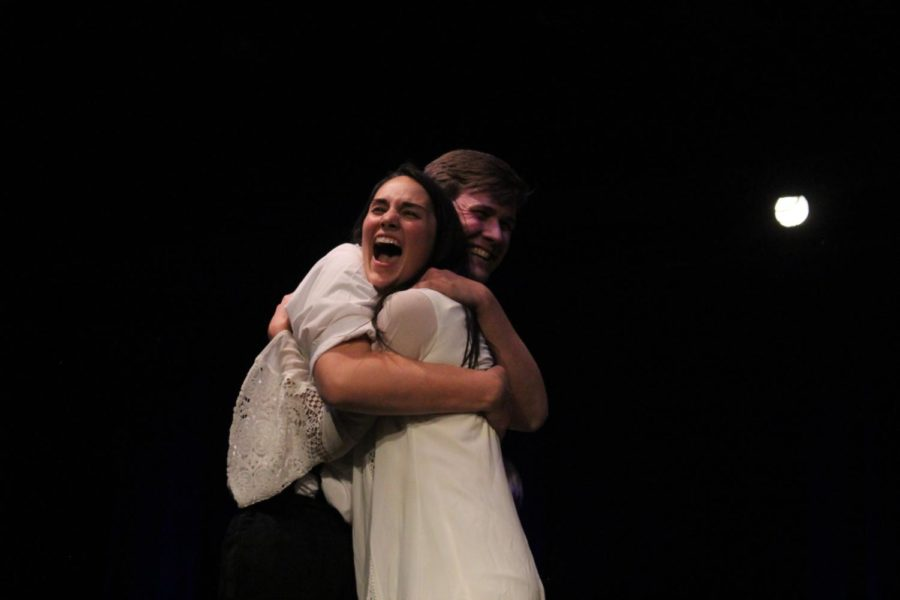 Maggie Nave and Spencer Pelfrey hug it out in front of the crowd. During this performance, all of the contestants performed at the same time.