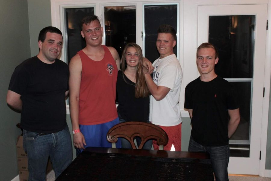 Lucie Rutherford (middle) stands with her four older brothers on Thanksgiving of 2016.