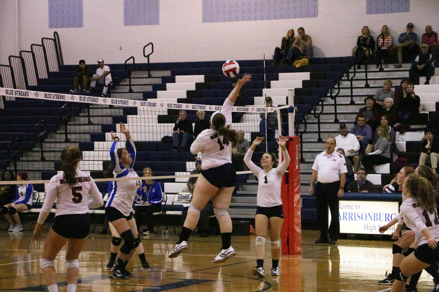 Junior Rebecca Staton returns the ball with a spike back at William Fleming.