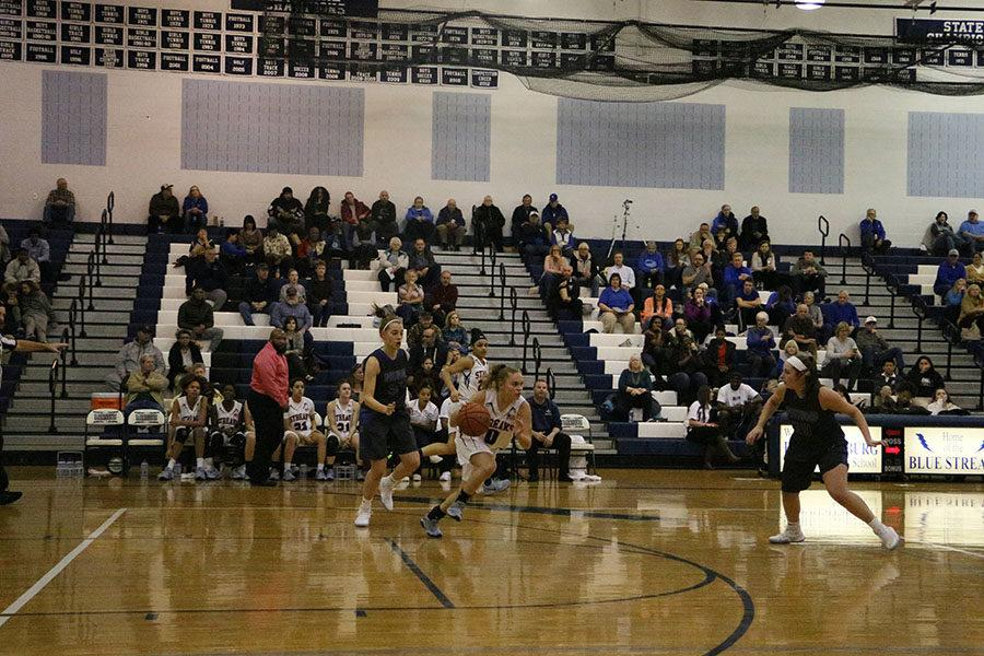 Senior Marissa Madden takes off down the court past Spotswood's defenders.