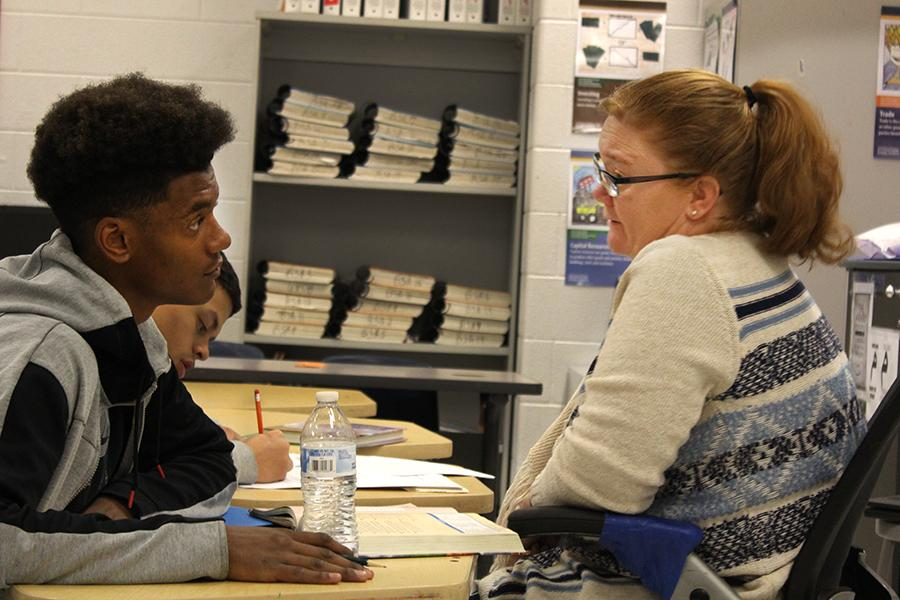 "Junior D'Andre Moats works with teacher Melissa Thurman	 during night school. ""[Night school] is more interaction,"" Moats said. ""If you would like a teacher in front of you, helping you a lot more, I would recommend night school."""