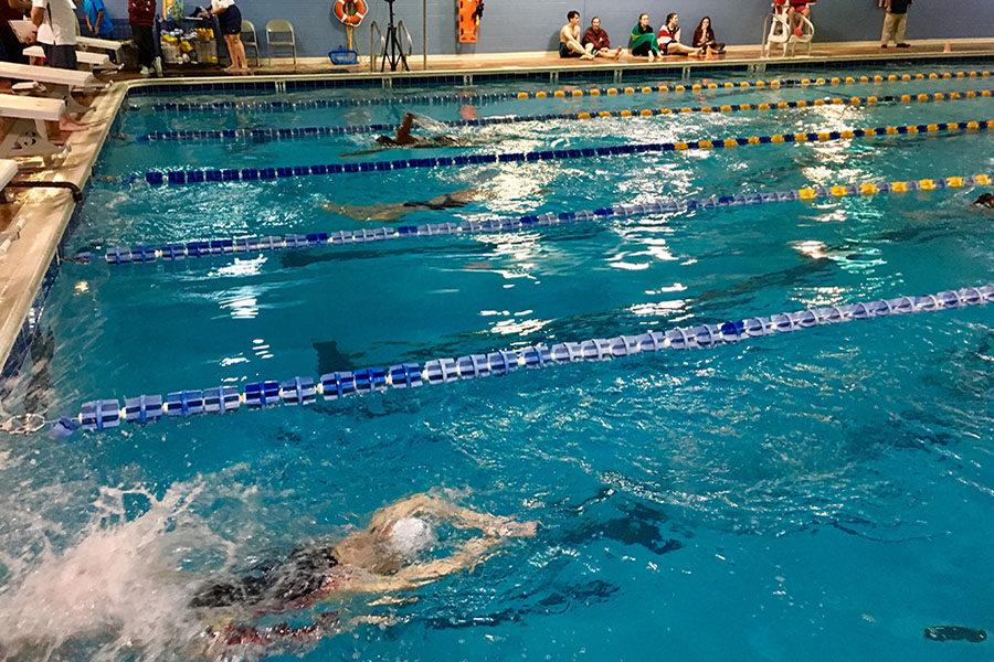 Christa Cole pushes off the wall in the 200 meter freestyle.