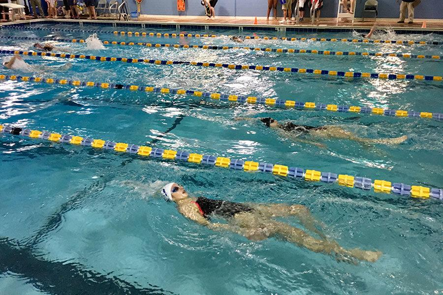Freshman Isabel Campillo competes in the 100 meter backstroke.