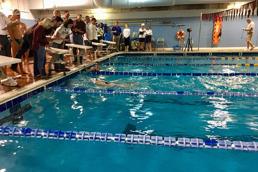 Junior Samantha Little finishes the 100 meter backstroke race.