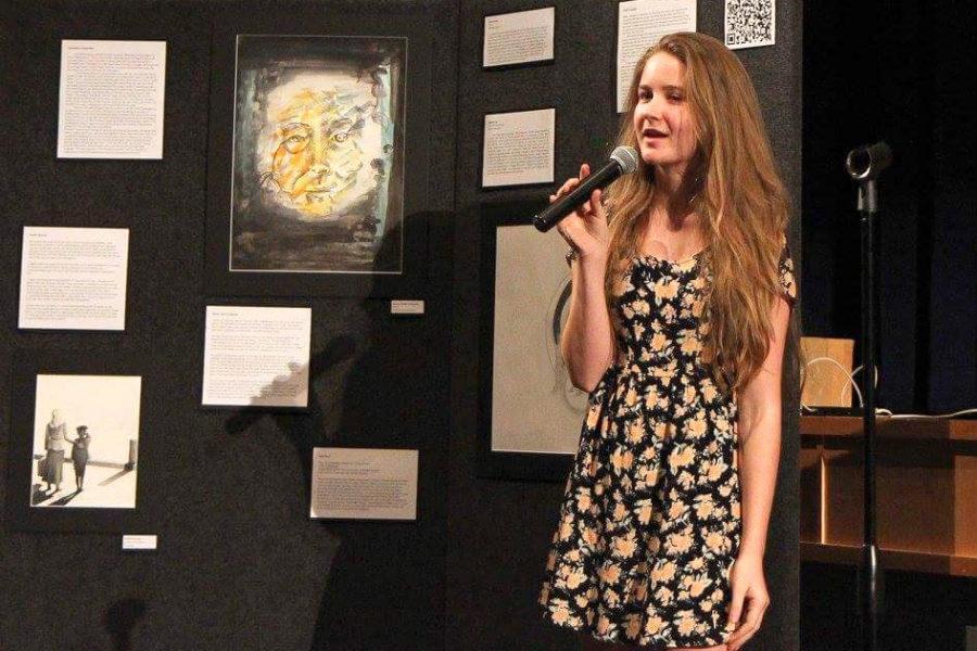 Snell-Feikema+talks+about+her+art+at+a+senior+fine+arts+showcase.