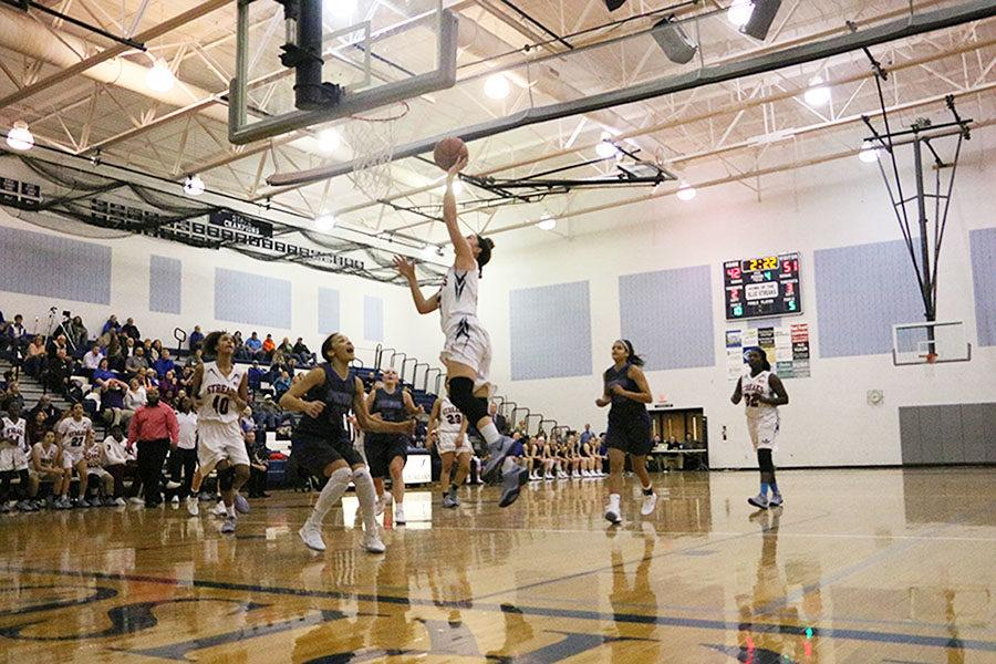 Senior Constance Komara scores a layup in the final quarter, as the Streaks attempted to come back. The Streaks ended up losing 56-46 against Spotswood.