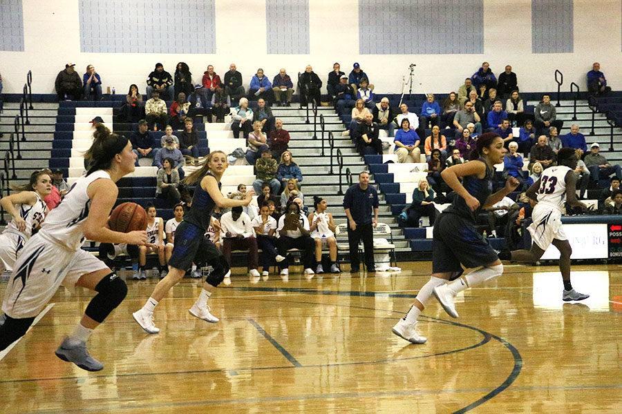Senior Constance Komara speeds down the ball down the court back to Harrisonburg's side.