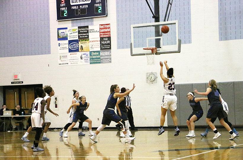 Sophomore Jakaya Brandon attempts a three-pointer.
