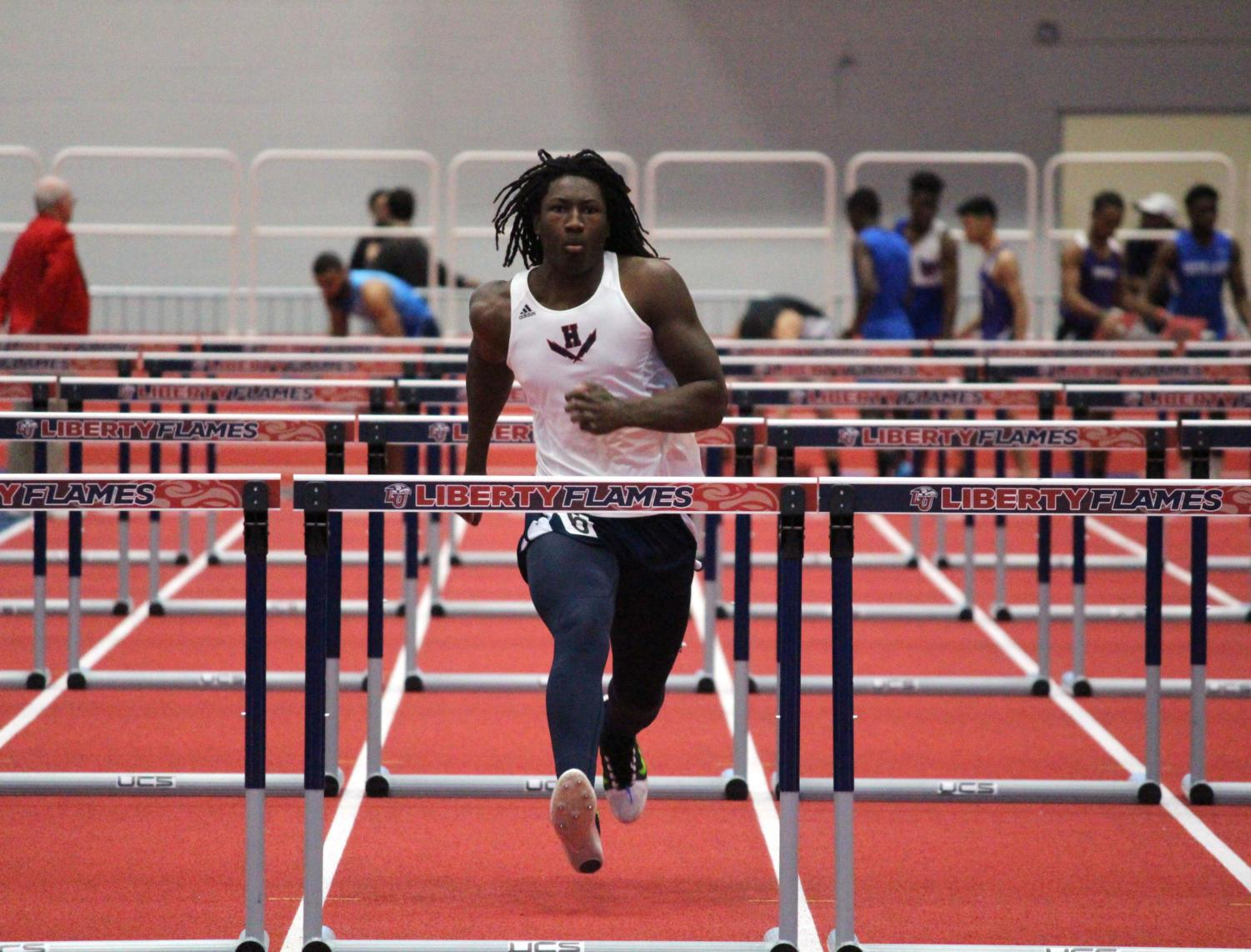 Sophomore Jaylin Smith approaches the final hurdle in the men's 55 meter hurdles. Smith set a personal record with a time of 9.86.