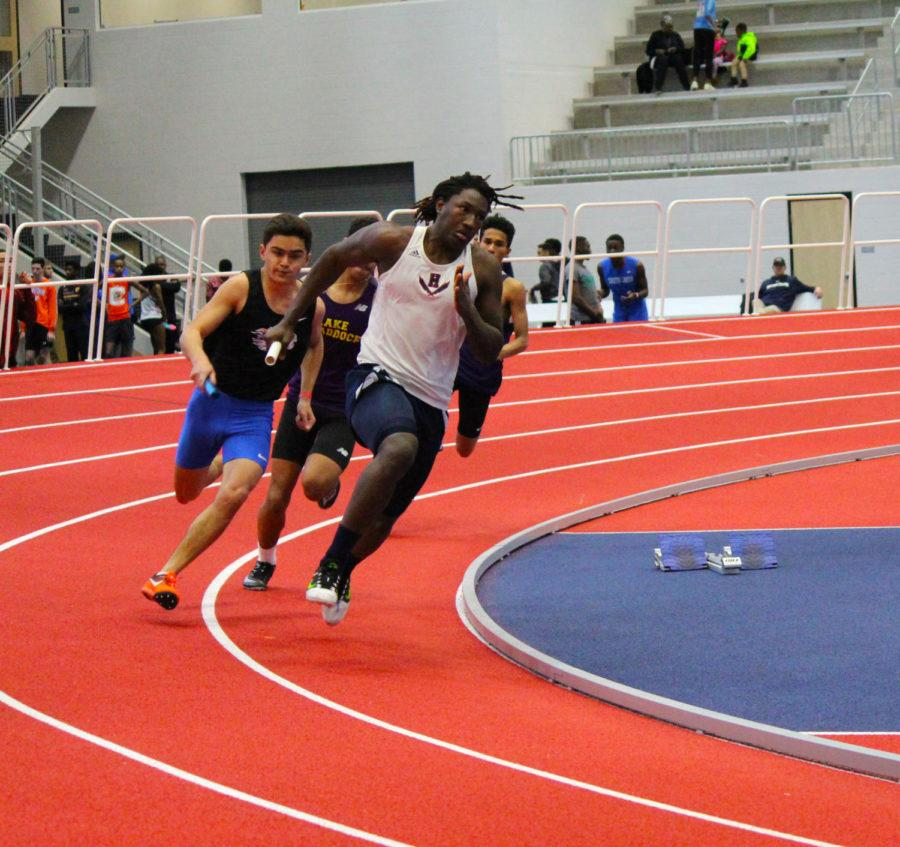 Sophomore+Jaylin+Smith+holds+off+runners+from+other+schools+in+his+leg+of+the+4x200+meter+relay.+The+team+finished+with+a+time+of+1%3A40.