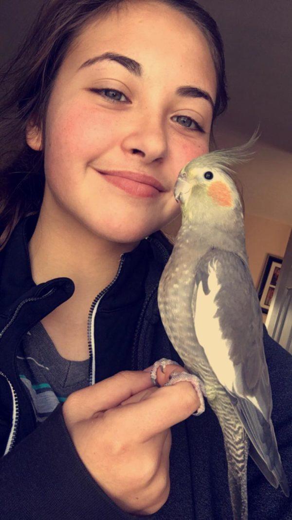 Malashiy poses with her bird, Jojo