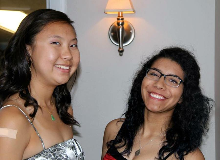 Isabella Marian (right) gets ready for her high school senior year Homecoming.