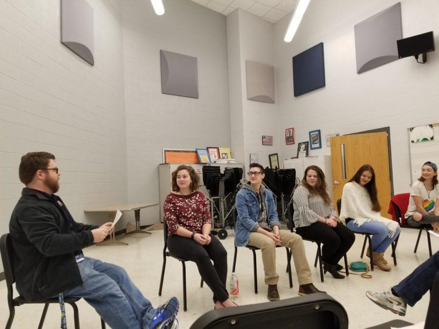 (Left to right) Physics teacher and head of GSA Seth Berkeley leads sophomore Faith Evans-Haywood, senior Derek Shifflett, freshmen Jordyn McHone and Genesis Marshall and junior Heather Whetzel in a discussion about pizza to shake out any nerves.