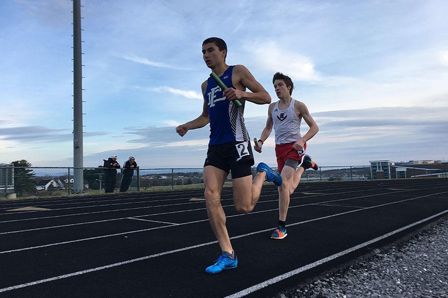 Freshman David Beck runs in the co-ed medley relay.