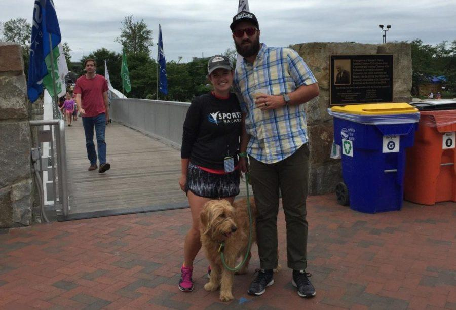 Nan Callahan and her husband, Tyler, attend a Sports Backer event with their dog. Callahan was working the event, Dominion Energy Rock.