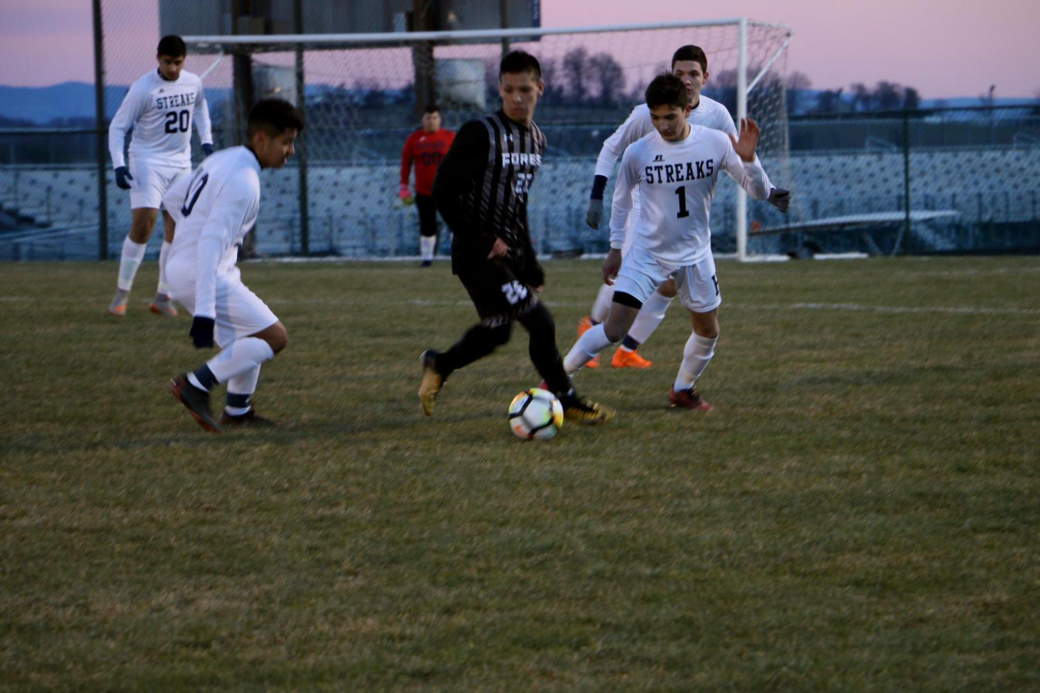 Senior Eric Ramirez and sophomore Jonathan Pulido double-team on the opponent.