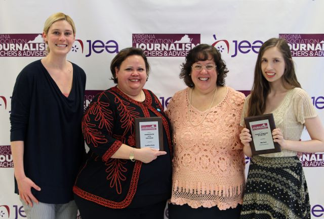 Mia Karr (right) receives the Virginia Association of Journalism and Journalism Education Association award for Virginia Journalist of the year in 2015.