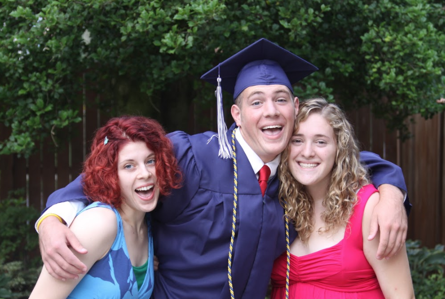 Colin Newcity poses with his two sisters, Aidan Newcity (left) and Allison Newcity, after his high school graduation in 2009.