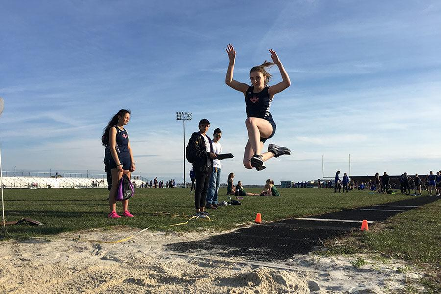 Freshman Sydney Shaver competes in long jump.