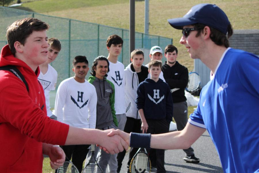 Opposing+teams+are+introduced+with+a+friendly+handshake+prior+to+the+game.