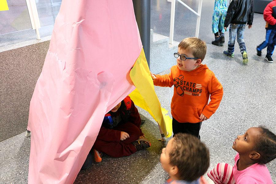 Kindergarteners examine one of the prototypes at the showing.