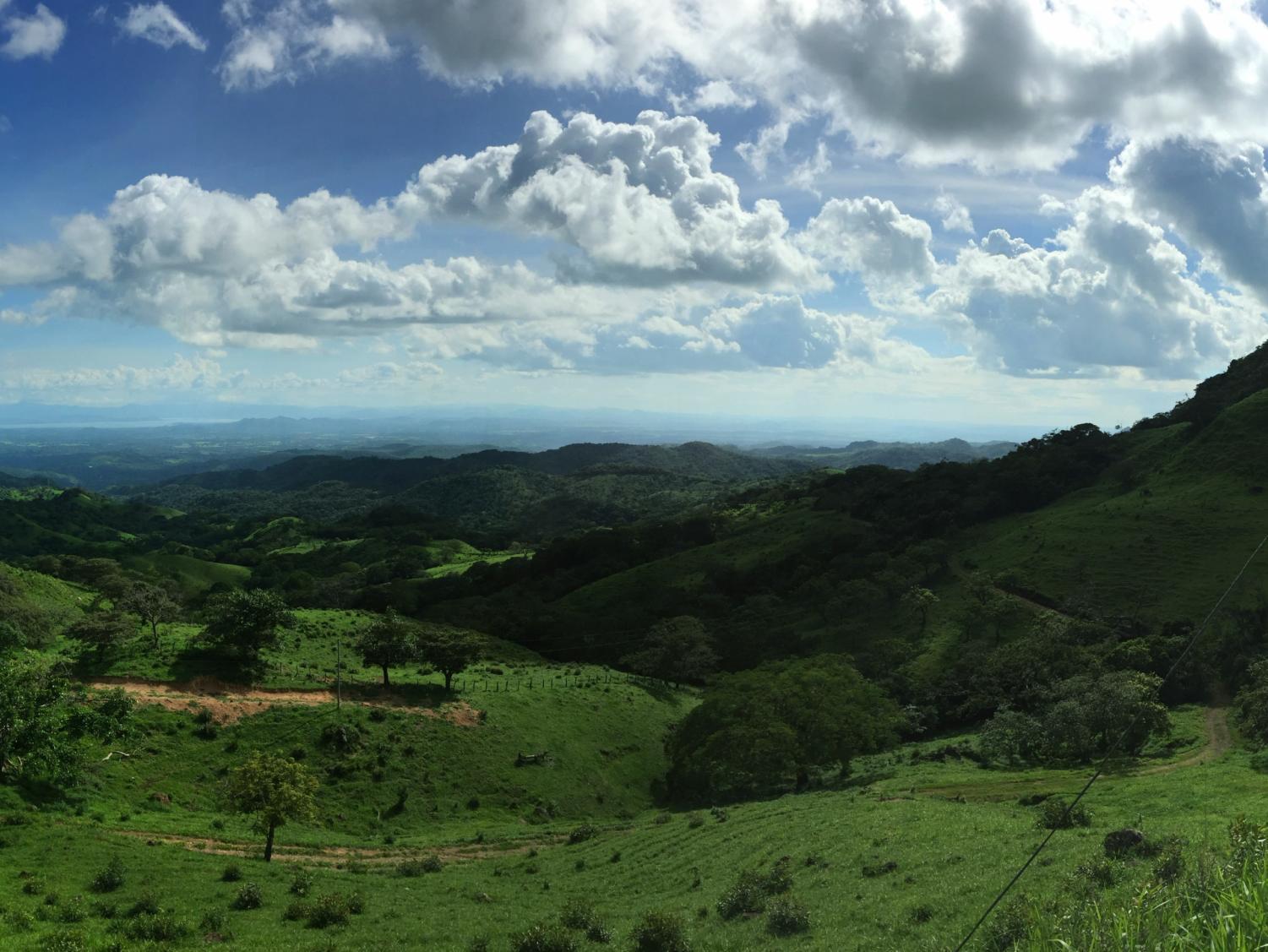 A roadside stop in Costa Rica overlooks an expanse of lush greenery.