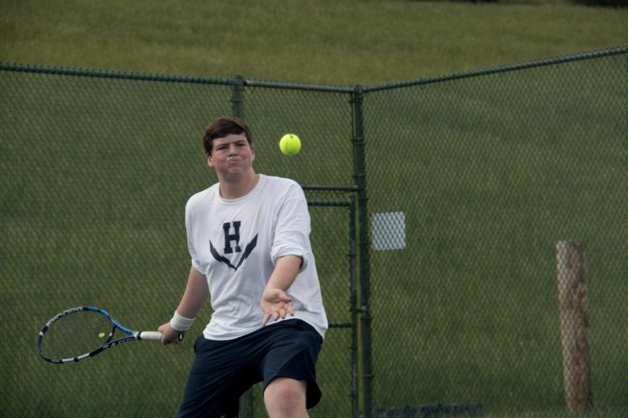 Junior Tobias Yoder forehands the ball
