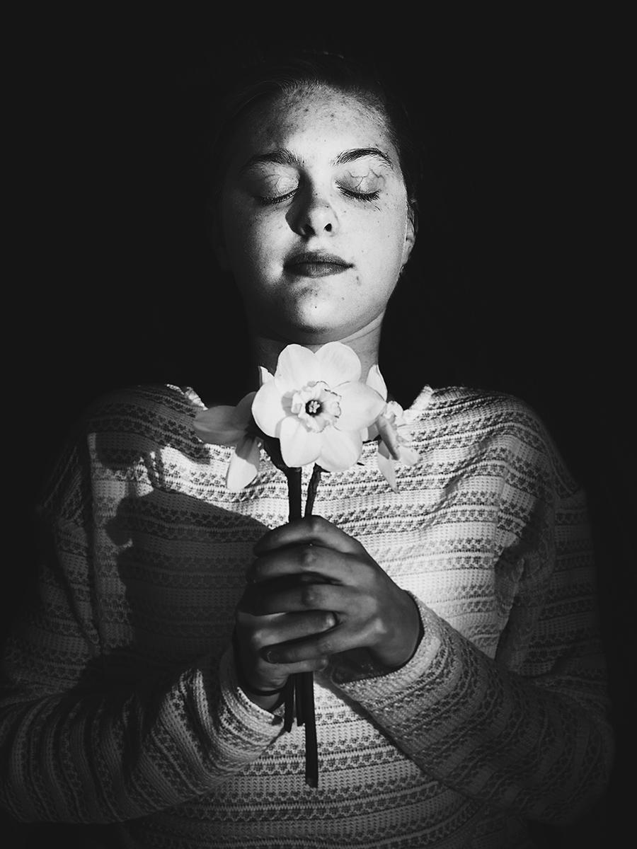 A girl lies dead, portrayed as Juliet.